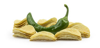 Stacks of chips with green pepper  on white background Stock Images