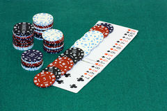 Stacks of chips and some playing cards Royalty Free Stock Image