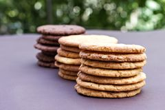 Stacks of chocolate cookies, cookies with chocolate drops, cookies with oatmeal. Different types of cookies. Stacks of chocolate cookies, cookies with chocolate Royalty Free Stock Photo