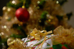 Stacks of Christmas Presents Under a Christmas Tree with Defocus. Ed Lights royalty free stock photography