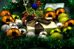 Stacks of Christmas presents under a Christmas tree with defocused lights.  stock image