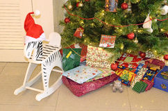 Stacks of Christmas presents under a Christmas tree. Stock image of Stacks of Christmas presents under a Christmas tree stock images