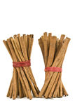 Stacks Of Cinnamon Sticks Isolated On White Stock Images