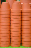 Stacks of clay flowerpots. Stacks of brown clay flowerpots on display Stock Photos