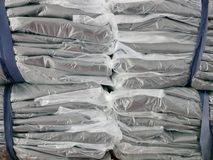 Stacks of clothes packed in plastic bags ready to be shipped / distributed. Selective focus and close up of stacks of clothes packed in plastic bags ready to be royalty free stock photography