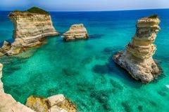 Stacks on the coast of Salento in Italy stock photos