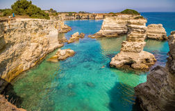 Stacks on the coast of Salento in Italy. Rocky stacks of Santo Andrea on the coast of Salento in Puglia in Italy Stock Photography