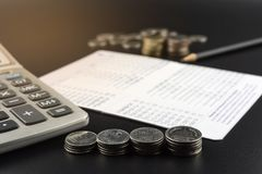Stacks of Coin and and calculator on Banking Account for Busines Royalty Free Stock Photo