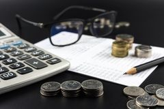 Stacks of Coin and and calculator on Banking Account for Busines Royalty Free Stock Photos