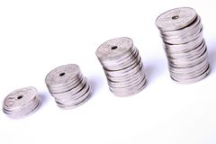 Stacks of coins. Stacks of Norwegian coins on white background Royalty Free Stock Image