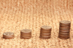 Stacks of coins. Success - stacks of coins on a mat Royalty Free Stock Image