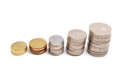 Stacks of coins. Savings, increasing columns of coins isolated on white background Royalty Free Stock Photo