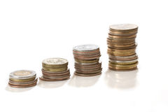 Stacks of coins. Isolated on white background stock photography
