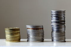Stacks of Coins in Ascending Order. Image of Three Stacks of Coins in Ascending Order illustrating Concept of Saving and Positive Investment Returns Stock Images