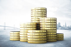 Stacks of coins concept with city view background Royalty Free Stock Photography