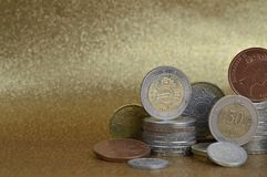 Stacks of coins from different nations with space stock photos