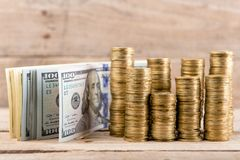 Stacks of coins and dollar bills stock image