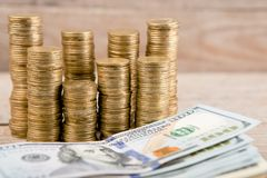 Stacks of coins and dollar bills royalty free stock photo