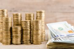 Stacks of coins and dollar bills royalty free stock photography