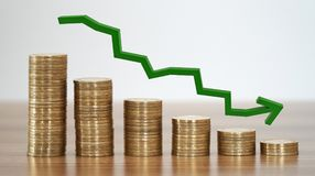 Stacks Of Coins Down. Stacks of coins in a decrease financial concept Stock Photography