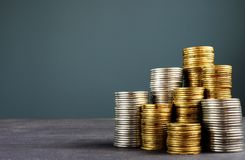 Stacks of coins and free space. Wealth, finance or investment. Stock Photos