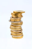 Stacks of coins in front a white background Royalty Free Stock Image