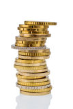Stacks of coins in front of white background Royalty Free Stock Image
