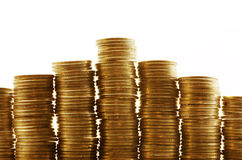 Stacks of coins. Golden coins in high stacks royalty free stock photography