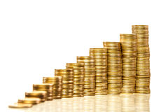 Stacks of coins. Stacks of golden coins isolated Royalty Free Stock Image