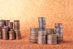 Stacks of coins. On golden sparkle background. Financial concept Royalty Free Stock Photos