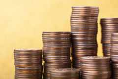 Stacks of coins. On golden sparkle background. Financial concept Royalty Free Stock Image