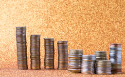 Stacks of coins. On golden sparkle background. Financial concept Royalty Free Stock Photo