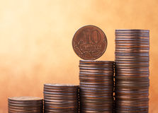 Stacks of coins. On golden sparkle background. Financial concept Royalty Free Stock Photography