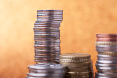 Stacks of coins. On golden sparkle background. Financial concept Stock Photography