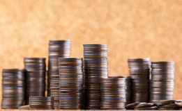 Stacks of coins. On golden sparkle background. Financial concept Stock Image