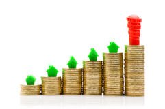 Stacks of coins, green and red home Stock Image
