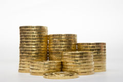 Stacks of coins increasing height uniformly Royalty Free Stock Photos