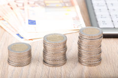 Stacks of coins increasing in size Stock Images