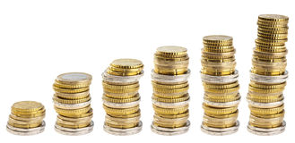 Stacks of coins isolated Royalty Free Stock Photography