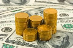 Stacks of coins on money background Stock Photos