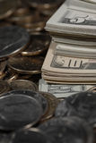 Stacks of Coins and Money Representing Wealth Success and Riches Royalty Free Stock Image