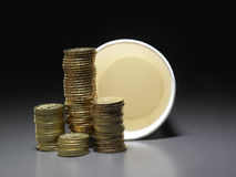 Stacks of coins and paper cup Stock Photography