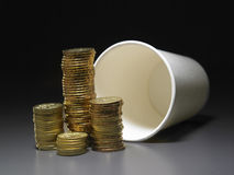 Stacks of coins and paper cup Stock Photos