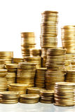 Stacks of coins. Piles of coins isolated on background Royalty Free Stock Image