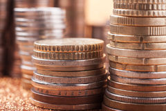 Stacks of coins. Stack of coins on golden sparkle background. Financial concept Royalty Free Stock Images