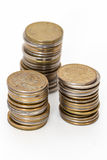 Stacks of coins. Three stacks of coins close up on white background Stock Image