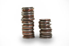 Stacks of Coins. Two isolated stacks of American coins stock images