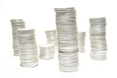 Stacks of coins on white Stock Image