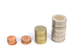 Stacks of coins on white background Royalty Free Stock Images