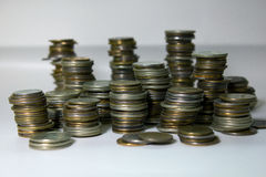 Stacks of coins on a white background Stock Images